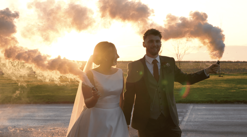 Married couple walking with the sunset behind them